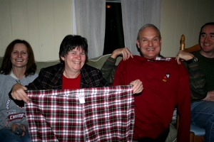 And the winners are...My sister Terri and her husband Bob had the final choice and opted for the giant jammies - Room for 2 in there? Ho Ho Ho! Now, the question, what items from last year's regifting might show up again in this year's ReGifting Grab?