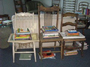 In this pic, gardening books are stacked atop vintage chairs... What was I thinking when I took up gardening for my 40th birthday and bought a dozen books on the topic - not very eco-friendly... Sharing them is, though!